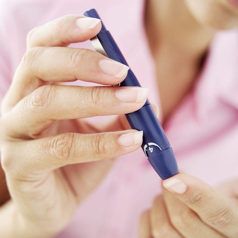Diabetes-woman accuchecking